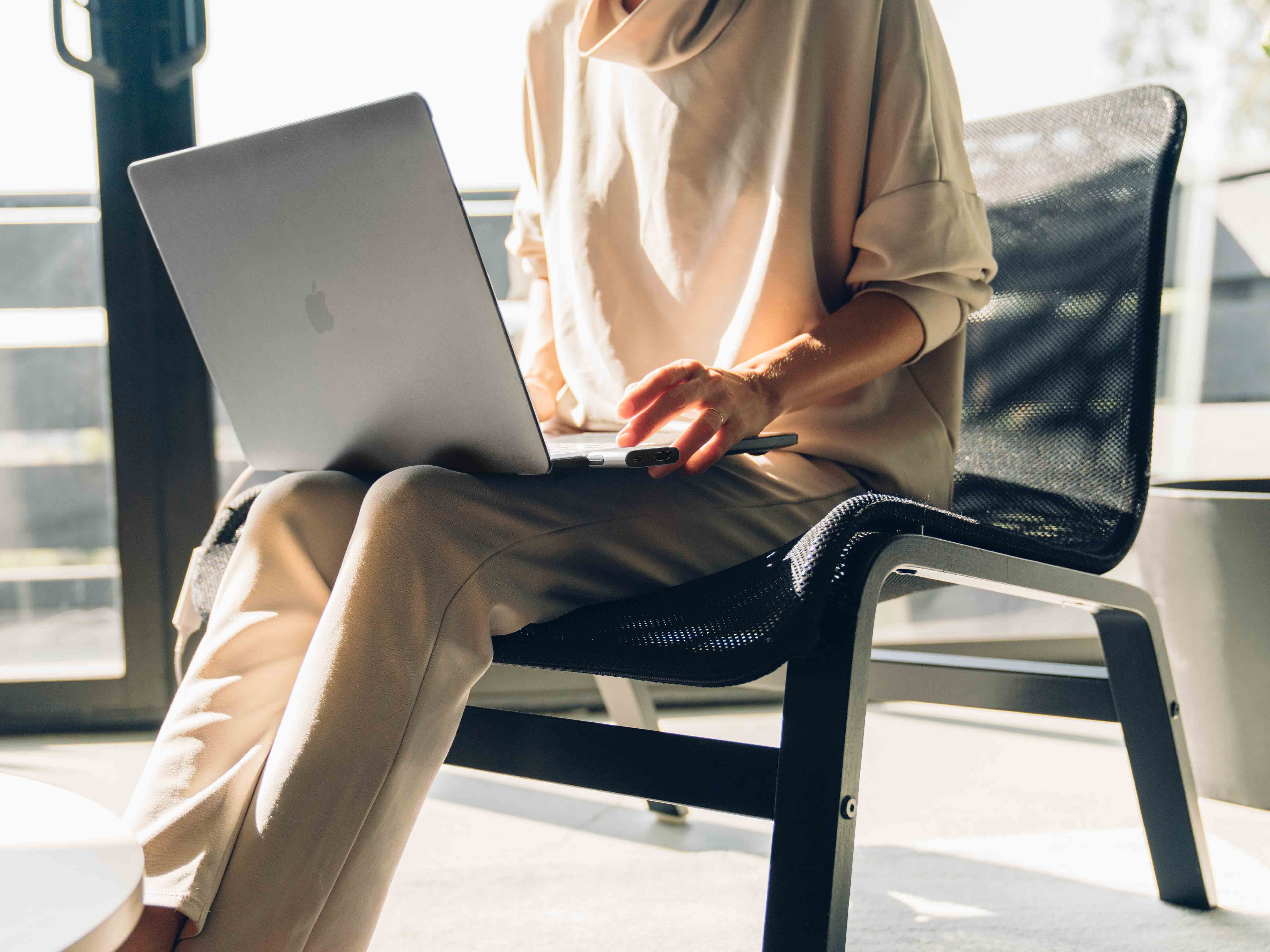 Woman sit on chair with MacBook