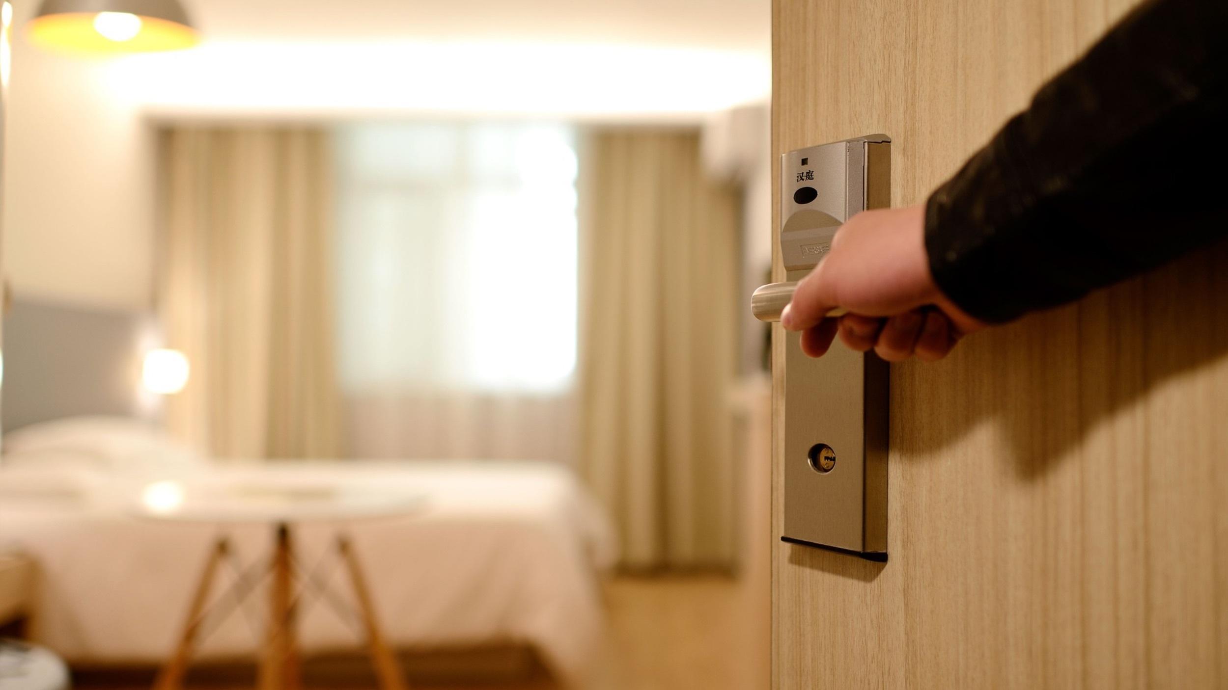 Opening the door of a hotel room