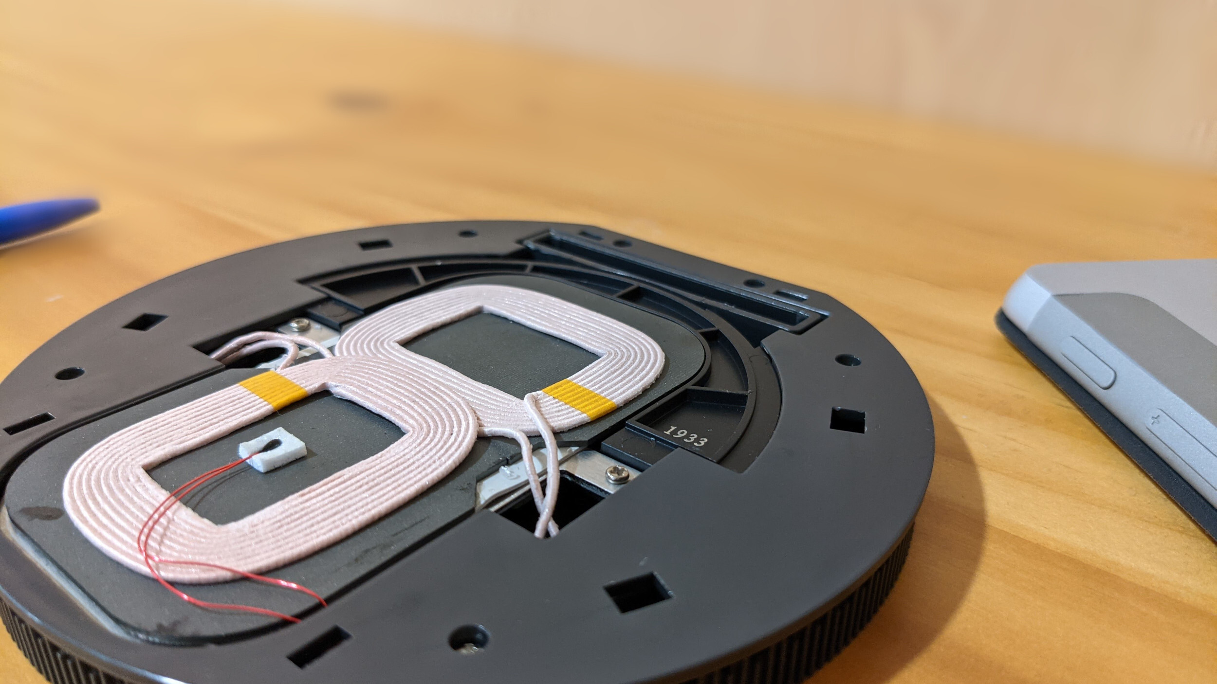 A close-up view of the inside of a multi-coil wireless charger