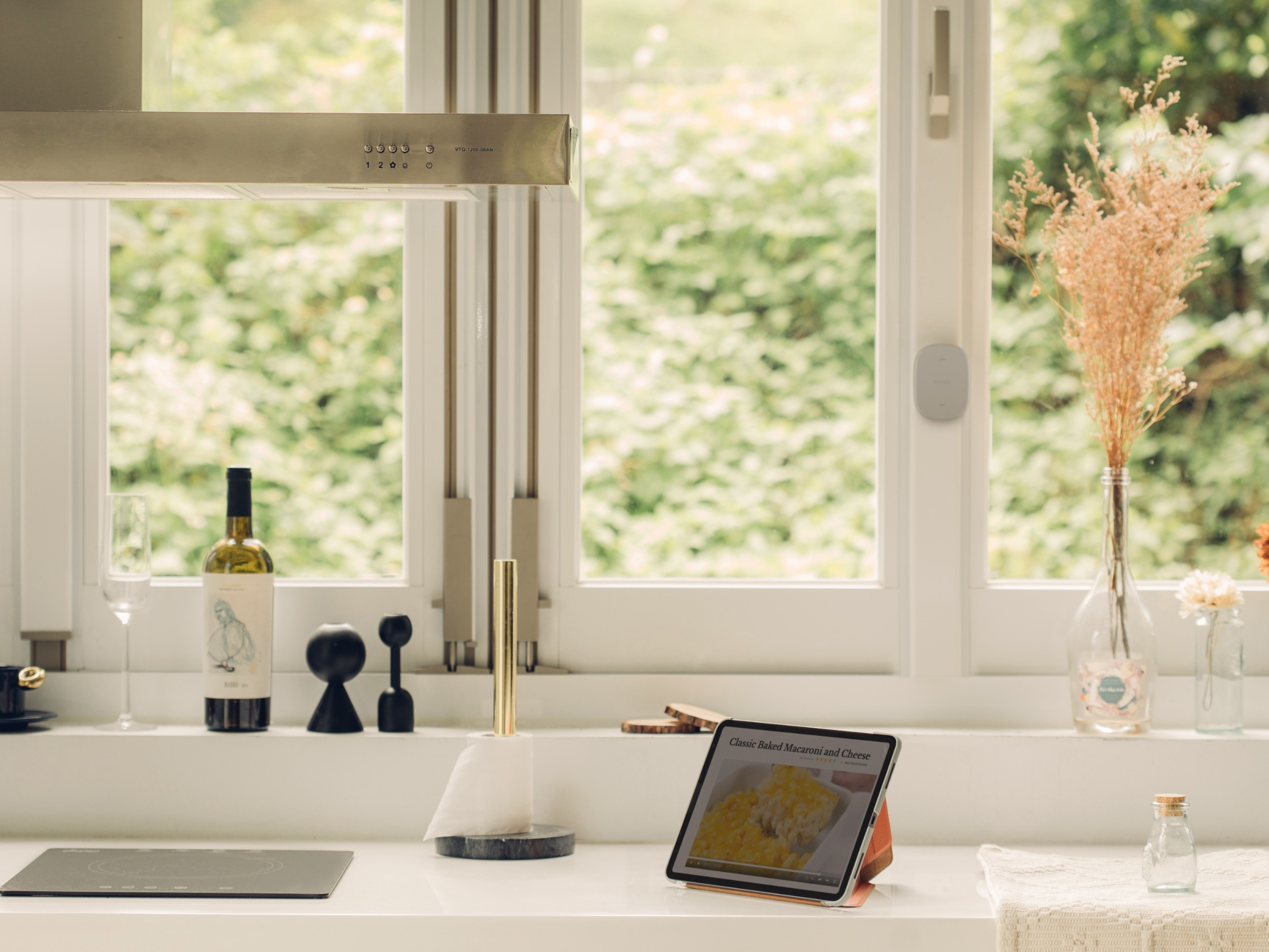 Modern western style kitchen with an iPad standing in landscape mode on the counter