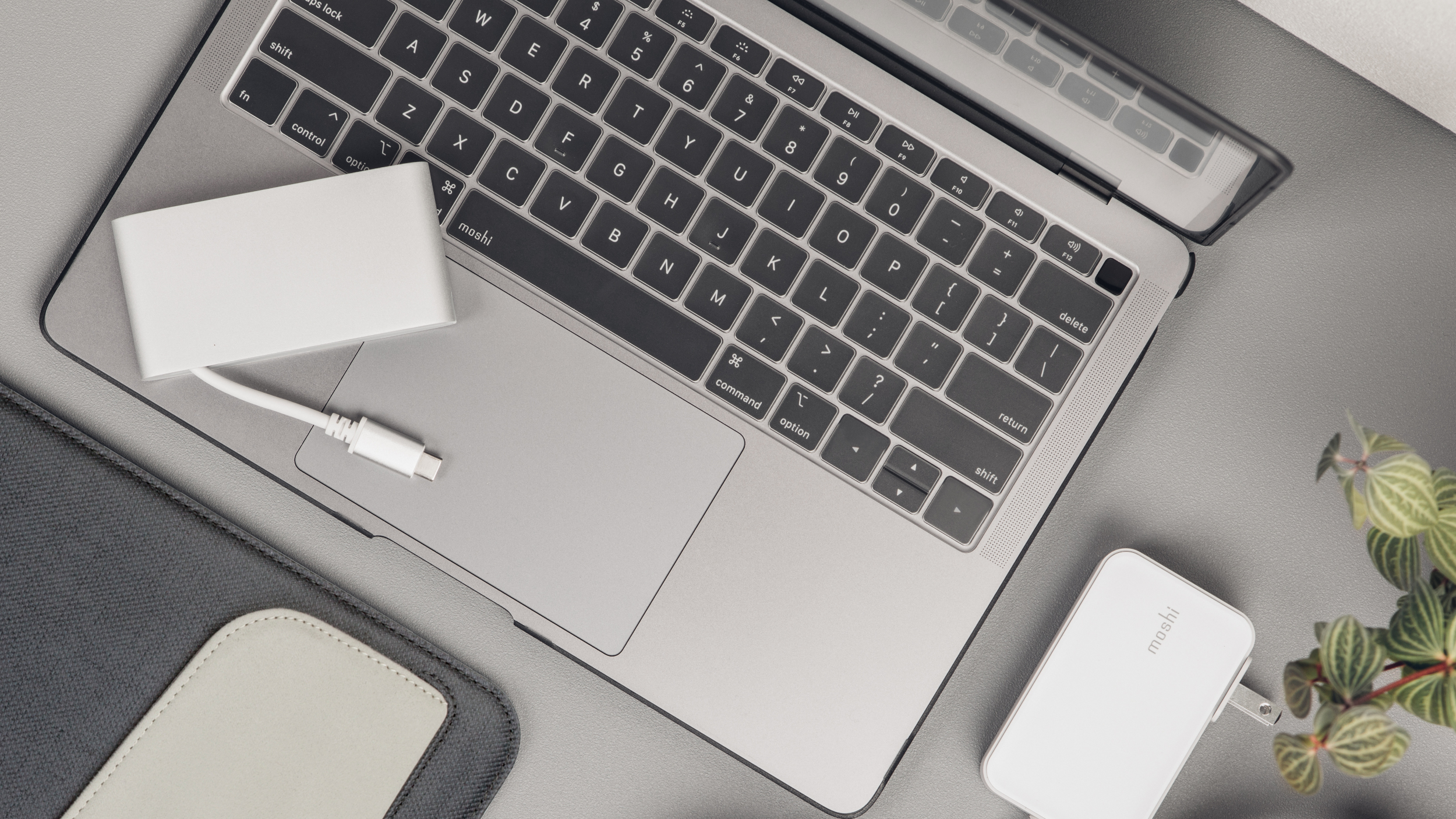 A top-down view of a MacBook computer on a desk