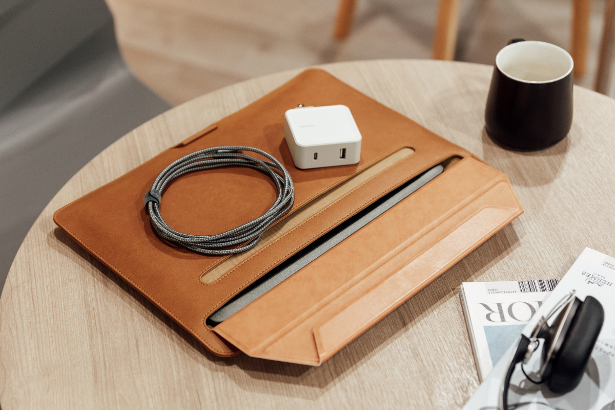This slim sleeve can fit laptops up to 13 inches and has a storage compartment for adapters and cables. Whether you're working from home or on the go, Muse can store all your laptop's essentials.