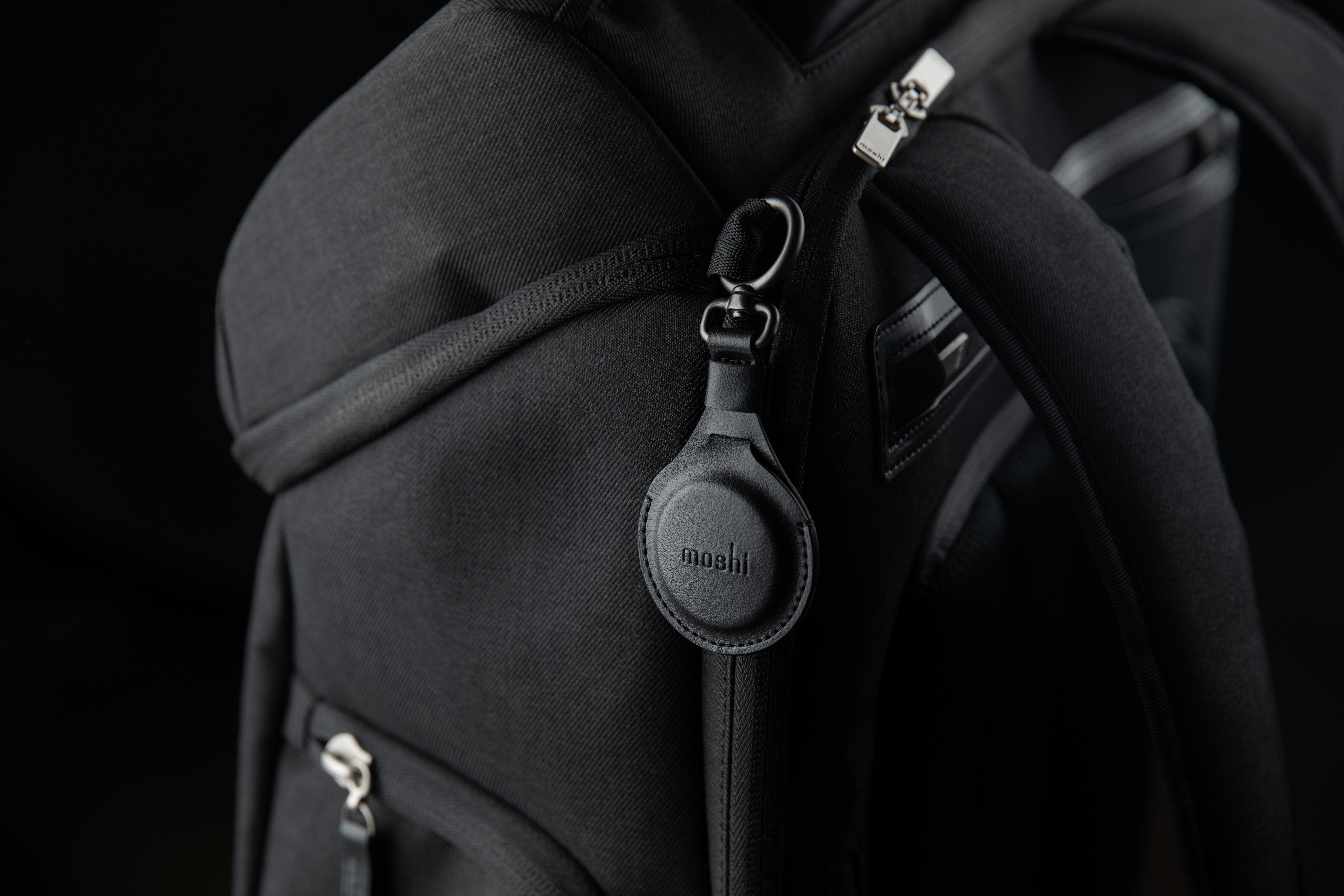 A Moshi backpack with an AirTag Key Ring attached