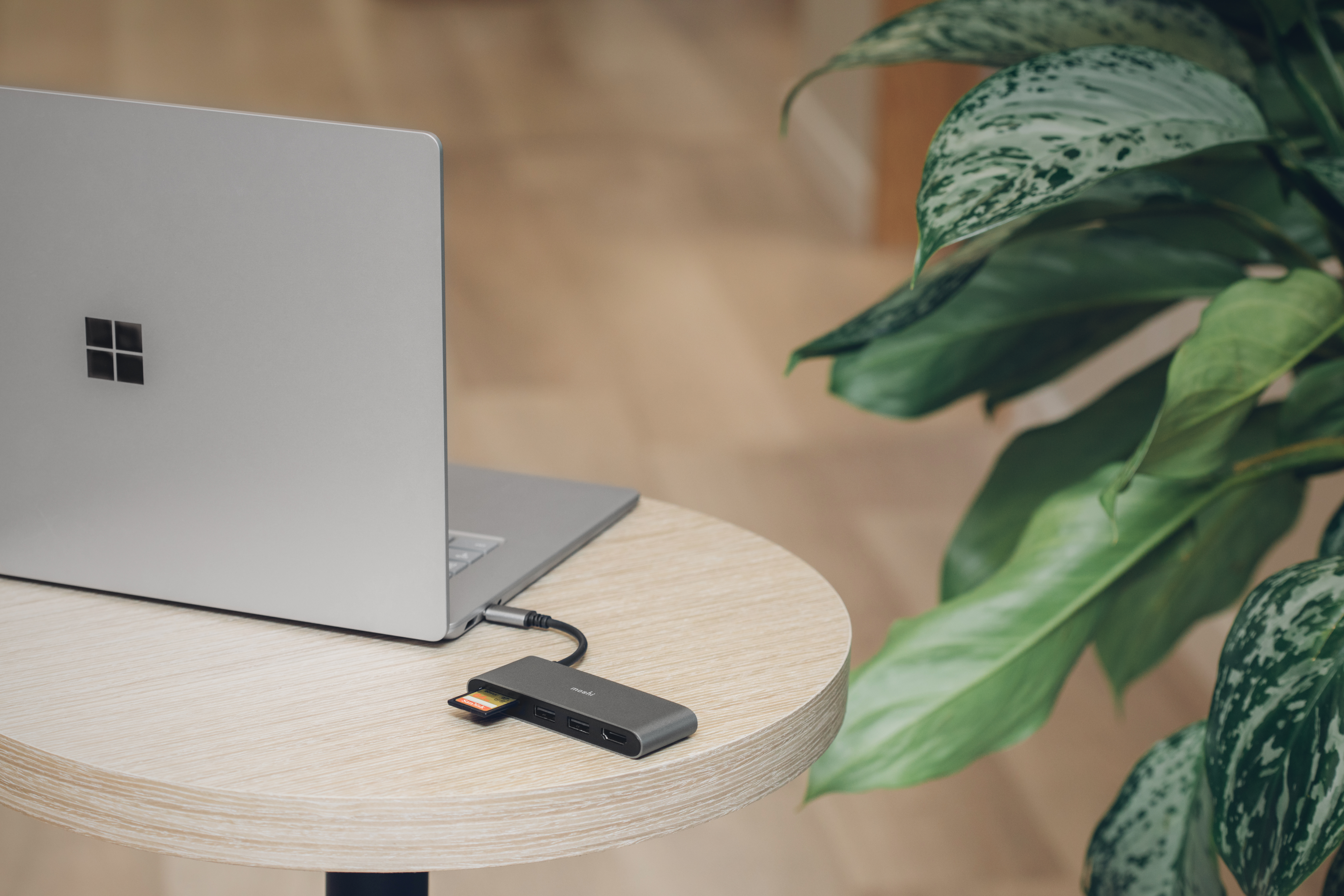 A Moshi USB-C Multimedia Adapter connected to a Surface Laptop