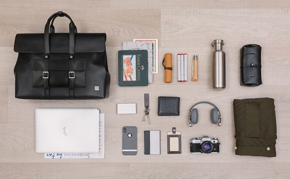 """Treya holds up to a 15"""" laptop, and other everyday items such as a portable battery, cables."""