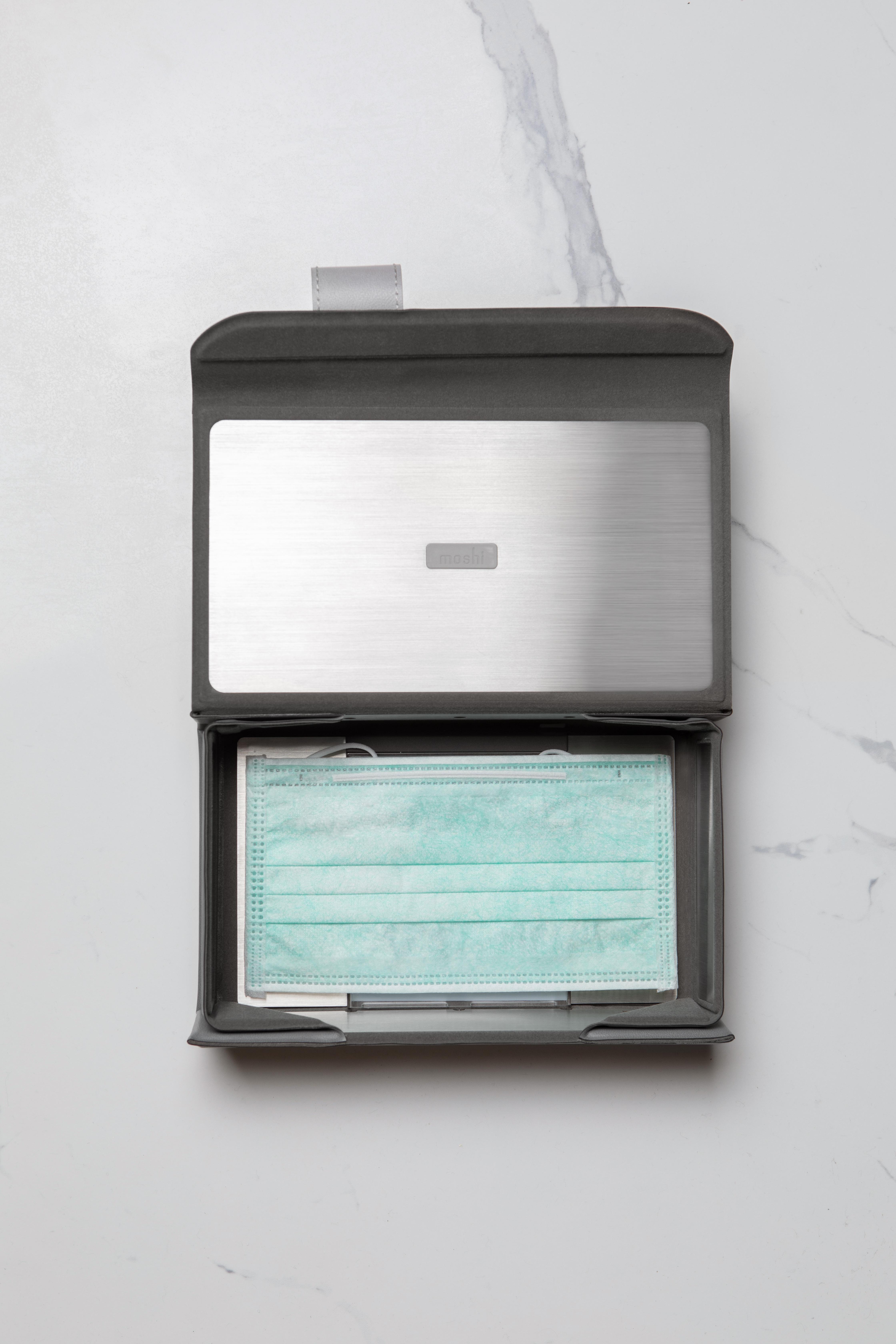A disposable surgical mask inside a Moshi Deep Purple UV sanitizer