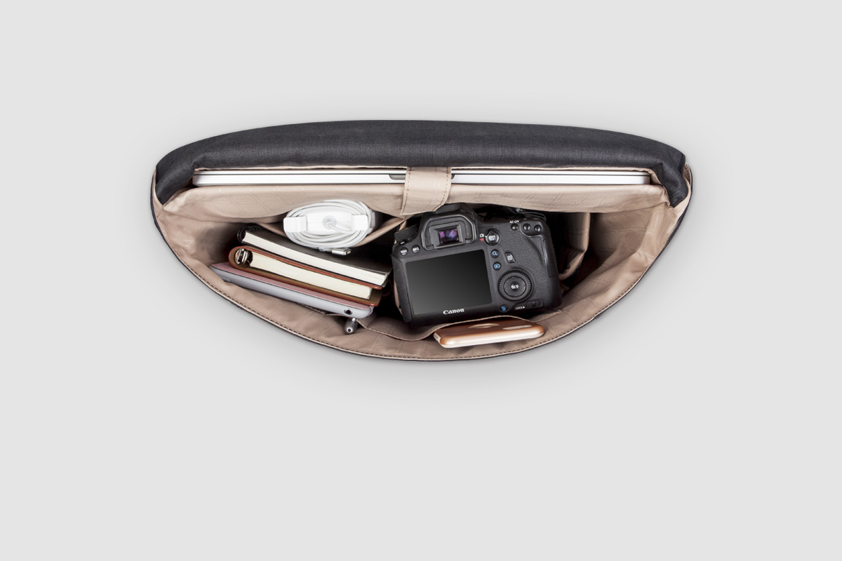"A dedicated, cushioned compartment accommodates laptops up to 16"" and provides maximum protection during transport. Additional compartments allow you to stash your tablet, smartphone, and headphones or camera, as well as a full-length zippered document pocket."