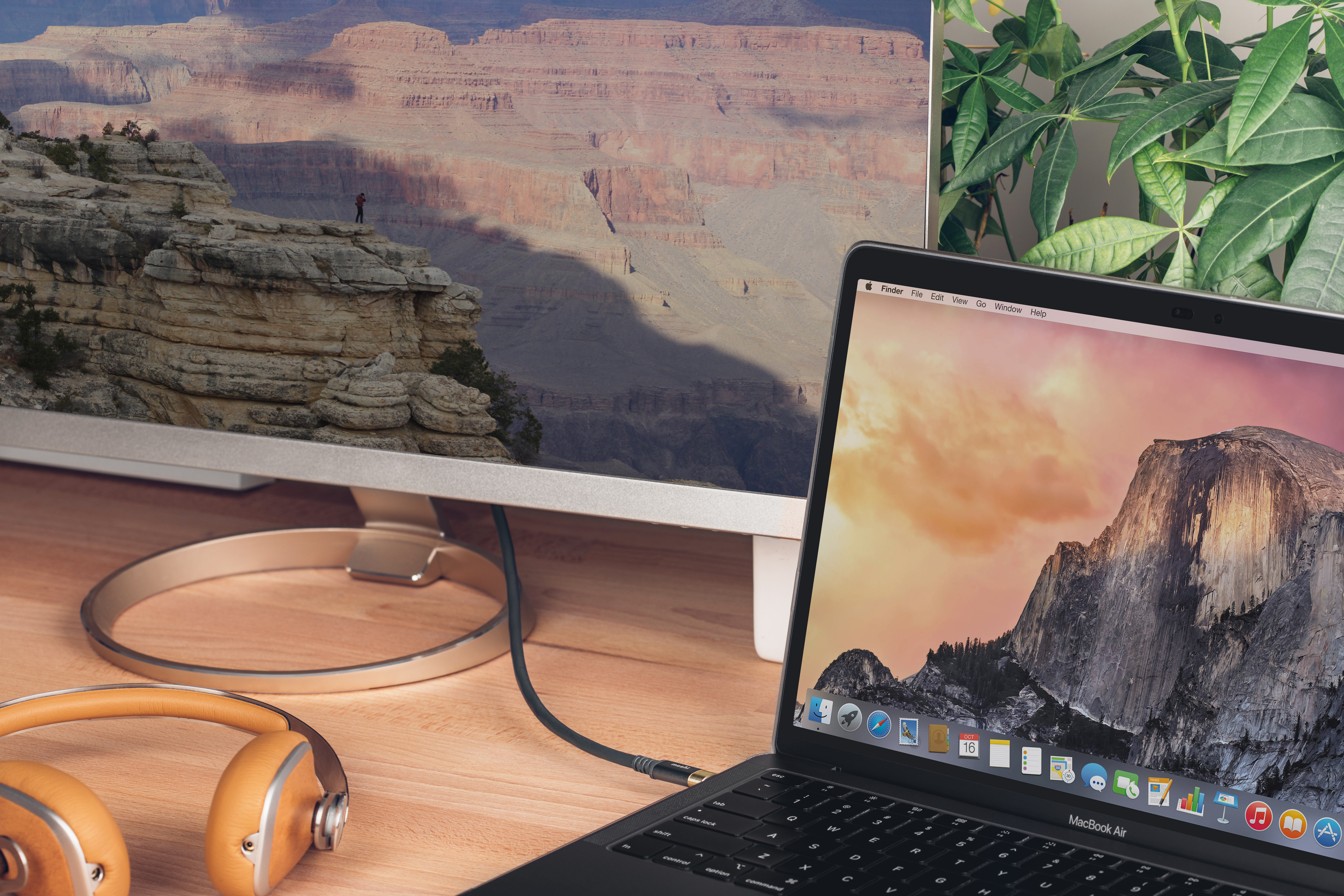 A desktop setup with a computer connected to a monitor using a USB-C monitor cable