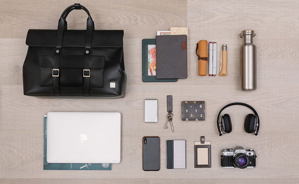 """Treya Lite holds up to a 13"""" laptop, and other everyday items such as a portable battery, cables, documents and more."""