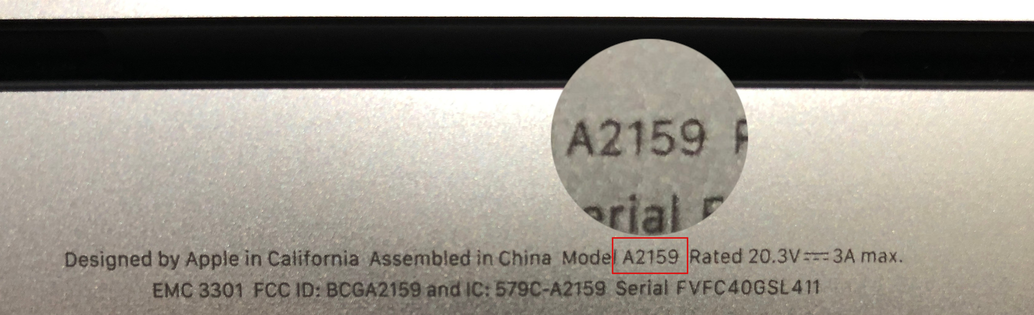 The underside of a MacBook laptop showing the product information