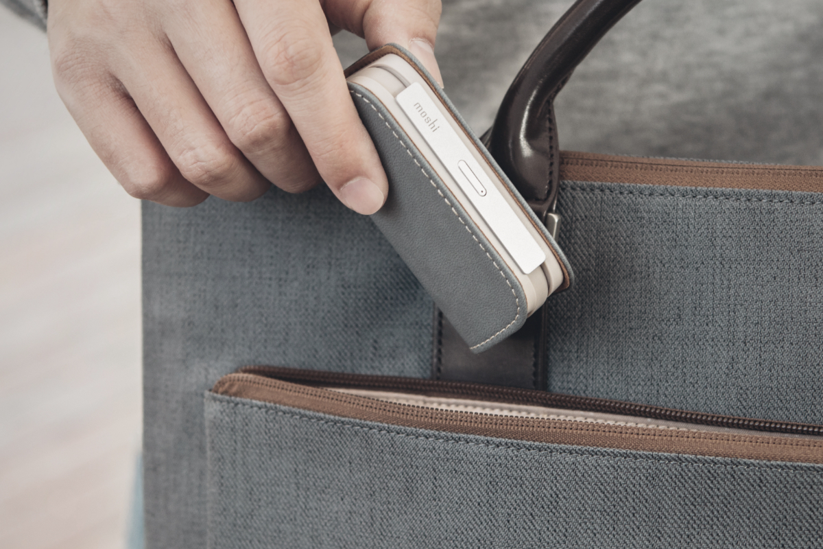 Modeled after the key fob of a luxury car with a luxurious vegan leather cover, magnetic closure, and anodized aluminium accents. Small enough to fit in a pocket, bag, or purse.